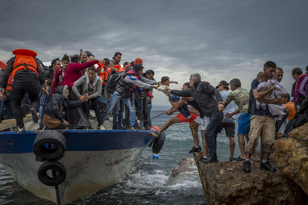 Oct. 11, 2015 - Lesbos Island, Greece - Refugees and Migrants aboard fishing boat driven by smugglers reach the coast of the Greek Island of Lesbos after crossing the Aegean sea from Turkey. (Credit Image: © Antonio Masiello/NurPhoto via ZUMA Press)